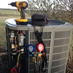 AC unit repair with tool kit and power drill