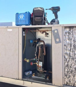 commercial HVAC maintenance with tool kit and power drill
