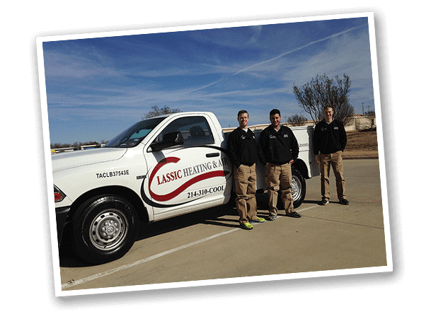 3 employees pose with Classic Heating & Air pickup truck