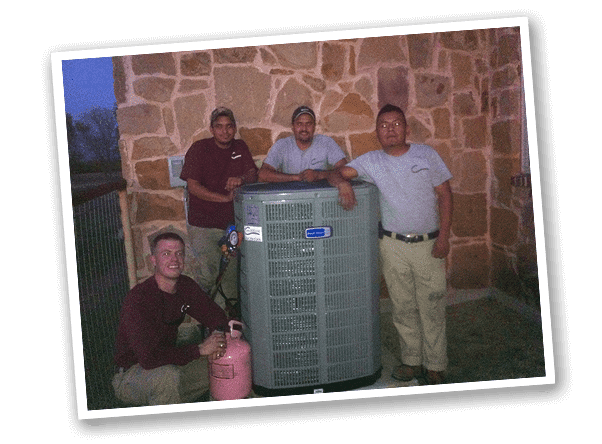 Classic Heating & Air employees pose with an AC Unit